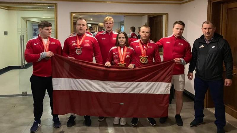 Medaļotā Latvijas svarcelšanas komanda mājās atgriezīsies šodien