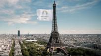 """Vējš neļauj Eifeļa tornī pacelt milzu karogu ar uzrakstu """"Paris 2024"""""""
